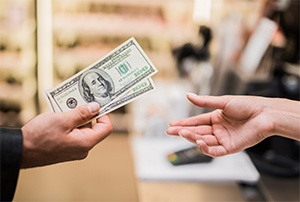 Paying Cash at Retail Location